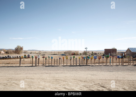 A long row of mailboxes in the country side - Stock Photo