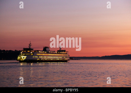Washington State Ferry sailing from Seattle at twilight. Bright point in sky is Venus. - Stock Photo