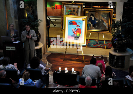 Art auction in The Centrum, The MS 'Jewel of the Seas' Royal Caribbean International cruise ship, North Sea, Europe - Stock Photo