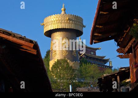 Giant prayer wheel at Guishan Gongyuan in Shangri-La or Zhongdian in Yunnan Province, China - Stock Photo