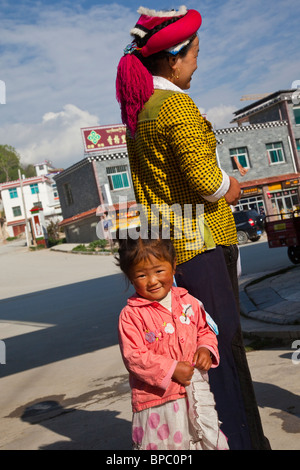 Ethnic minority Chinese girl in Shangri-La or Zhongdian in Yunnan Province, China - Stock Photo