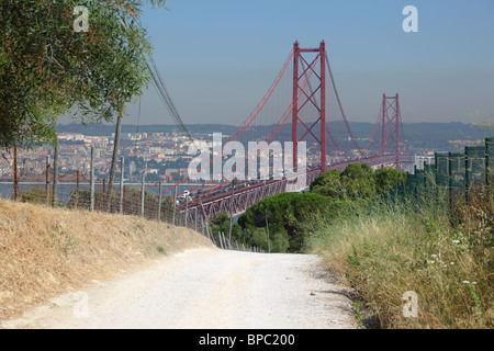 Ponte 25 de Abril - Suspension bridge over the Tagus river in Lisbon, Portugal - Stock Photo