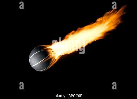 A Basketball with a burning tail like a comet - Stock Photo