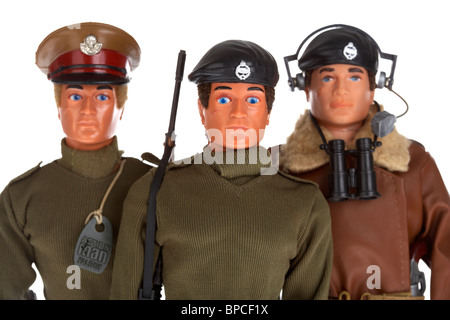 collection vintage action men including basic soldier talking commander and tank commander - Stock Photo