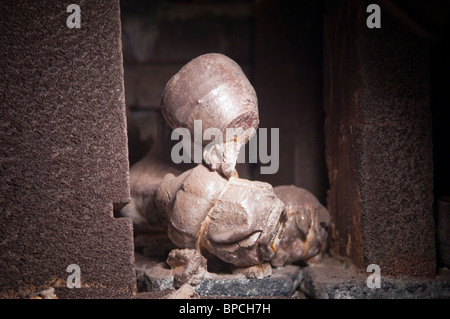 Pots stuck together with wadding after being fired in an anagama kiln - Stock Photo