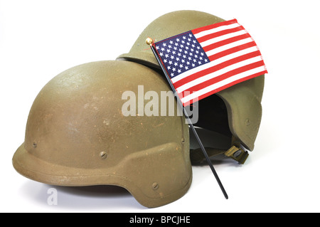 Kevlar military helmets and American flag isolated on white background. - Stock Photo