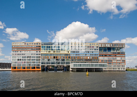 Amsterdam Netherlands modern architecture Apartments on Westerdoksdijkand between Oude Houthaven  and IJ port Harbor - Stock Photo