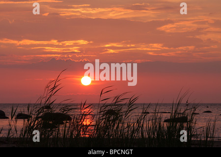 Sun set in Ruhnu - Stock Photo