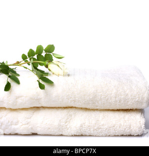 Bath towels with rose isolated on white - Stock Photo