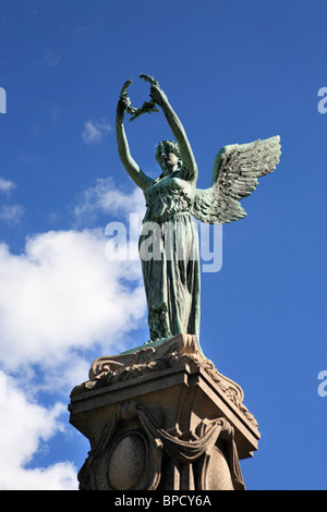 The sculpture in bronze of an angel above the Boer War memorial in Gateshead's Saltwell Park, Tyne and Wear, England - Stock Photo