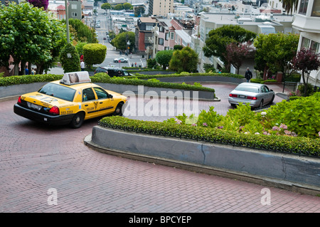 Lombard Street with yellow Taxicab, San Francisco, California, USA - Stock Photo