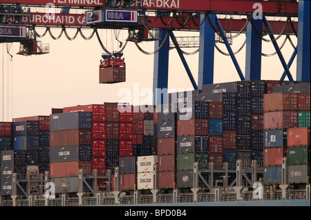 A container ship is being unloaded at the Container Terminal Burchardkai, Hamburg, Germany - Stock Photo
