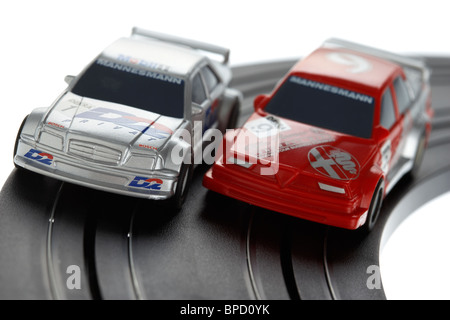 micro slot racing cars on track from the 1980s historic boys toy manufactured by scalextric - Stock Photo