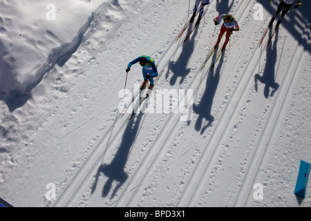 Winter Olympics, Vancouver, 2010 The shadows of athletes cast on the surface of the snow during the Men's 30km Pursuit. - Stock Photo