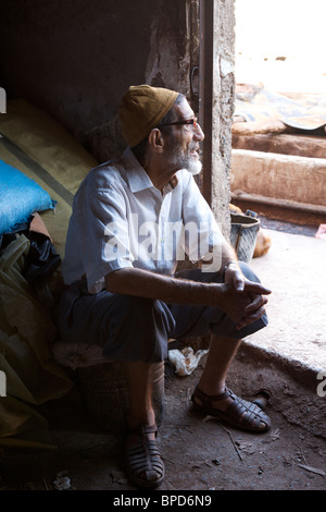 An old man takes a break from work at the tanneries, Marrakech, Morocco, North Africa - Stock Photo