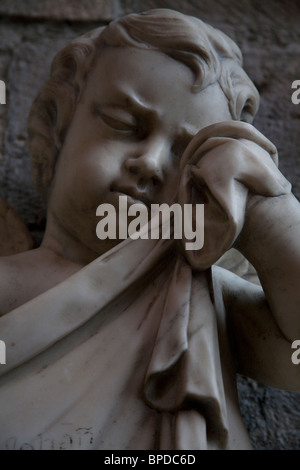Marble statue on a memorial of a child crying, Chichester Cathedral, Chichester West Sussex - Stock Photo