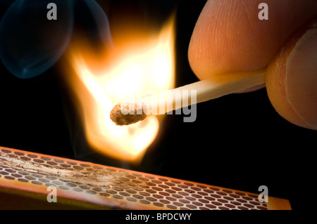 Striking a match - Stock Photo