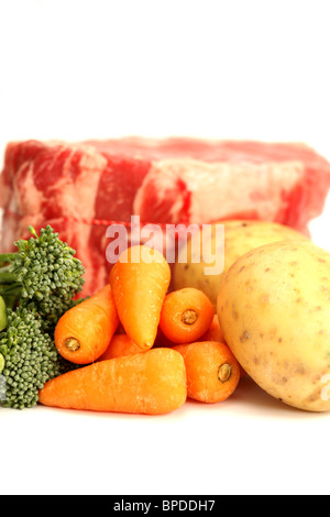 Ingredients For A Traditional Sunday Roast Dinner Of Beef Broccoli Potatoes And Carrots With No People Against A - Stock Photo