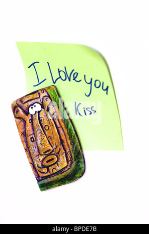Blank green adhesive note with 'I Love You' wording on white background with shadow - Stock Photo