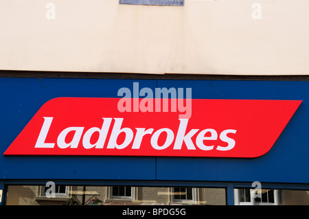 Ladbrokes Betting Shop sign logo, Ely Cambridgeshire, England, UK - Stock Photo