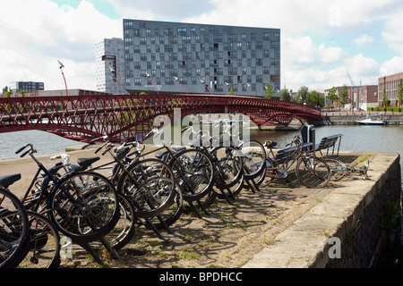 Eastern Docklands walk in Amsterdam - Stock Photo