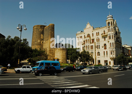 Baku, Azerbaijan, Old Maiden Tower and the beginning of Baku inner city walls, beside a white building, seen from - Stock Photo