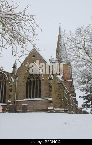 A rural english church in heavy snow. - Stock Photo