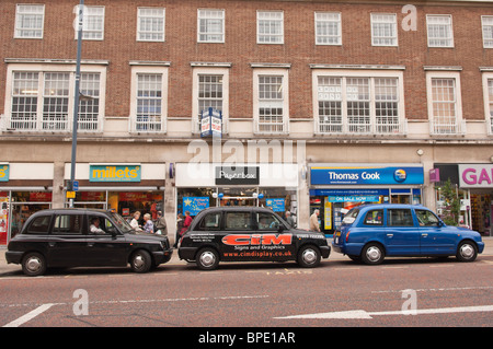 A row of Taxis waiting for customers in Norwich , Norfolk , England , Great Britain , Uk - Stock Photo