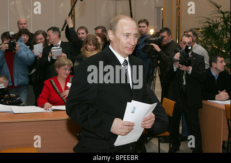 Russian President Vladimir Putin votes for a new president of Russia - Stock Photo