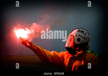 Lifeboat member with flare, Aberdovey, Gwynedd RNLI Aberdovey and Barmouth Lifeboats on Exercise, Gwynedd North - Stock Photo