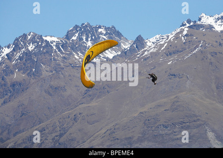 Paraglider over Mountains near Queenstown, South Island, New Zealand - Stock Photo
