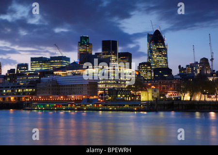 View over the River Thames at night looking toward the financial heart of the City of London - Stock Photo