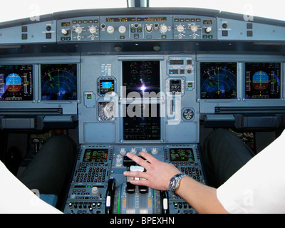 Flight deck of an Airbus 320 airplane - Stock Photo