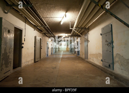 Underground cells in U-boat bunker at state secret security police or STASI prison at Hohenschönhausen in Berlin - Stock Photo