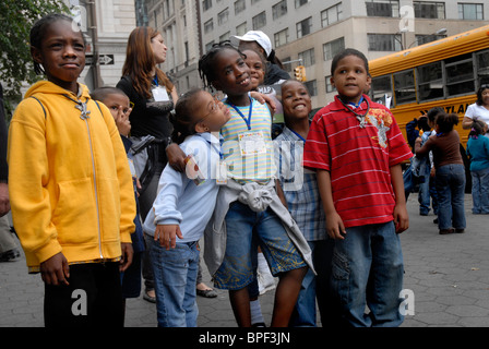 group of young children in streets of New York City - Stock Photo