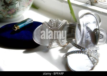 brides shoes on windowsill - Stock Photo