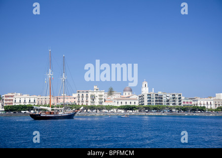 Wooden sailboat anchoring in the bay of Milazzo. - Stock Photo