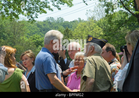 Bill Clinton and Hillary Clinton shake hands with World War II Veteran after Memorial Day parade in Chappaqua NY - Stock Photo