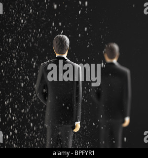 Two Figures In Falling Snow - Stock Photo