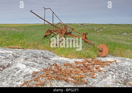 Scrapped and abandoned Island Crofting Aricultural Machinery South Uist Outer Hebrides, Western Isles, Scotland. - Stock Photo