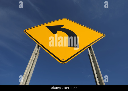 Canadian Left turn road sign - Stock Photo