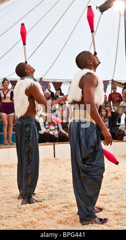 Jugglers Bichu and Bibi Tesfarmarium performing at Gifford's Circus - Stock Photo