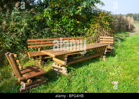 Wooden table and chairs standing in nature - Stock Photo