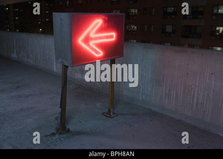 Illuminated arrow sign in a garage, Theater District, Boston, Suffolk County, Massachusetts, USA - Stock Photo
