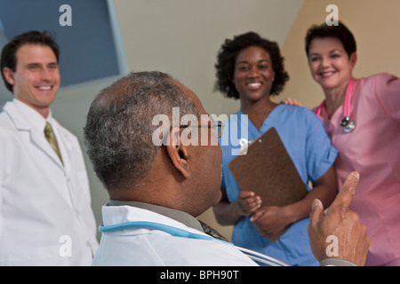 Doctor with his colleagues in a hospital - Stock Photo