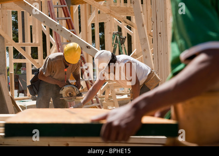 Carpenters sawing beam - Stock Photo