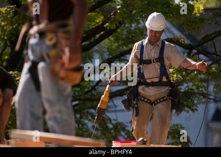 Carpenters using a reciprocal saw - Stock Photo