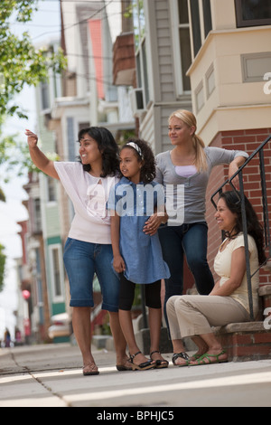 Two Hispanic women smiling with their daughters, Boston, Massachusetts, USA - Stock Photo
