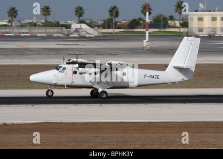 de Havilland Canada DHC-6 Twin Otter turboprop utility aircraft on the runway in Malta - Stock Photo