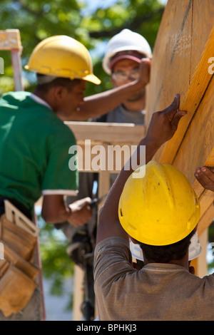 Carpenters lifting beam - Stock Photo